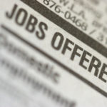 photo of job listings in the newspaper